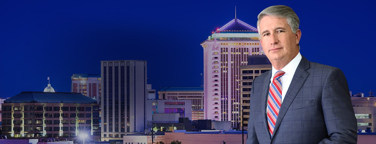 Hero Banner - Picture of C. Brandon Sellers, III over a city skyline
